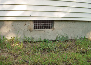 Open crawl space vents that let rodents, termites, and other pests in a home in Sudbury