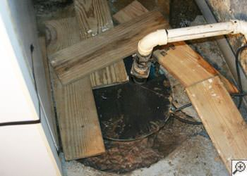 An ugly, clogged sump pump system in Sturgeon Falls, Ontario
