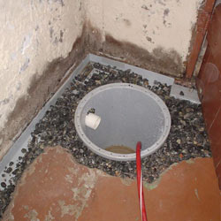 Installing a sump in a sump pump liner in a Espanola home