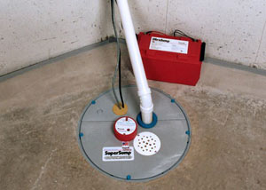 A sump pump system with a battery backup system installed in Coniston