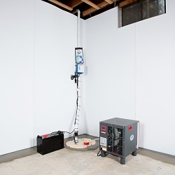 Sump pump system, dehumidifier, and basement wall panels installed during a sump pump installation in Espanola
